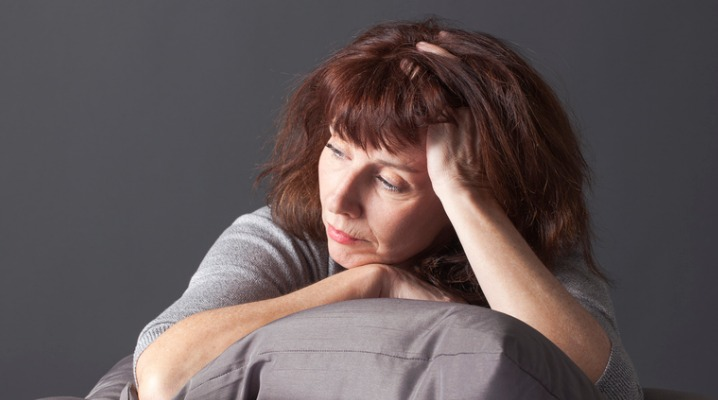 resigned-senior-woman-sick-of-having-menopause-blues-picture-id485073916-1