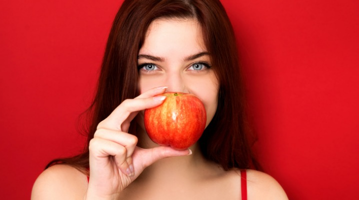 woman-holding-red-apple-picture-id1020200652-1